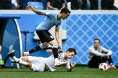 Matias Vecino, top, of Uruguay passes the ball against Benjamin Pavard of France in their quarterfinal match during the 2018 FIFA World Cup in Nizhny Novgorod, Russia, 6 July 2018