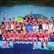 Children from China and Russia take photos in a su...