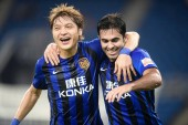 Italian-Brazilian football player Eder Citadin Martins of Jiangsu Suning, right, celebrates with his teammate Wang Song after scoring a goal against TianjinTEDA in their 19th round match during the 2018 Chinese Football Association Super League (CSL)