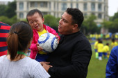 Brazilian football star Ronaldo Luis Nazario de Lima, right, commonly known as Ronaldo, visits one of his soccer schools in Shanghai, China, 20 May 2018.