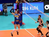 Cristina Chirichella, top, of Italy spikes against Risa Shinnabe of Japan in their third round match during the 2018 FIVB Women Volleyball Nations League in Hong Kong, China, 29 May 2018