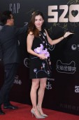 Hong Kong actress Cecilia Cheung poses as she arrives on the red carpet for Tmall baby awards in Shanghai, China, 17 May 2018.