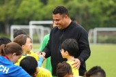 Brazilian football star Ronaldo Luis Nazario de Lima, center, commonly known as Ronaldo, visits one of his soccer schools in Shanghai, China, 20 May 2018.