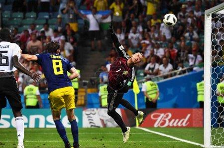 Robin Olsen of Sweden saves