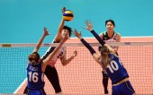 Haruyo Shimamura, top, of Japan spikes against Lucia Bosetti and Cristina Chirichella of Italy in their third round match during the 2018 FIVB Women Volleyball Nations League in Hong Kong, China, 29 May 2018
