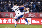 Italian-Brazilian football player Eder Citadin Martins, right, of Jiangsu Suning, challenges Chen Weiming of Guangzhou R&F in their 20th round match during the 2018 Chinese Football Association Super League (CSL) in Nanjing city, east China's Jiangsu
