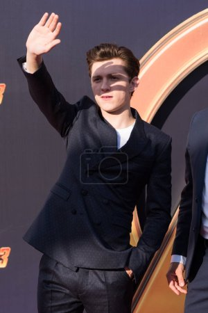 English actor Tom Holland poses