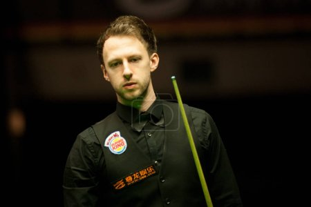 Judd Trump of England considers