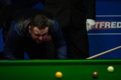 Stephen Maguire of Scotland considers a shot to Ronnie O'Sullivan of England in their first round match during the 2018 Betfred World Snooker Championship at the Crucible Theatre in Sheffield, UK, 21 April 2018.