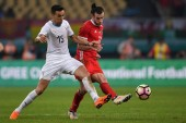 Gareth Bale, right, of Wales national football team kicks the ball to make a pass against Matias Vecino of Uruguay national football team in their final match during the 2018 Gree China Cup International Football Championship in Nanning city, south C