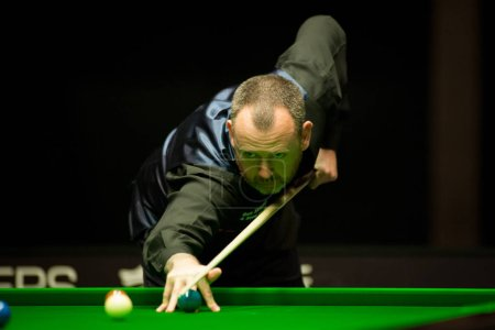 Mark Williams of Wales plays