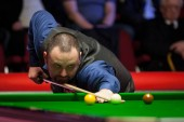Stephen Maguire of Scotland plays a shot to Li Hang of China in their first round match during the 2018 Ladbrokes World Grand Prix snooker tournament in Preston, UK, 20 February 2018