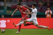 Gareth Bale, left, of Wales national football team kicks the ball to make a pass against Matias Vecino of Uruguay national football team in their final match during the 2018 Gree China Cup International Football Championship in Nanning city, south Ch