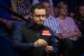 Stephen Maguire of Scotland chalks his cue as he considers a shot to Ronnie O'Sullivan of England in their first round match during the 2018 Betfred World Snooker Championship at the Crucible Theatre in Sheffield, UK, 21 April 2018.