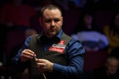 Stephen Maguire of Scotland chalks his cue as he considers a shot to Li Hang of China in their first round match during the 2018 Ladbrokes World Grand Prix snooker tournament in Preston, UK, 20 February 2018