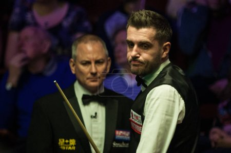 Mark Selby of England considers