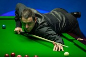 Ronnie O'Sullivan of England plays a shot to Stephen Maguire of Scotland in their first round match during the 2018 Betfred World Snooker Championship at the Crucible Theatre in Sheffield, UK, 21 April 2018.