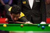 Li Hang of China plays a shot to Stephen Maguire of Scotland in their first round match during the 2018 Ladbrokes World Grand Prix snooker tournament in Preston, UK, 20 February 2018