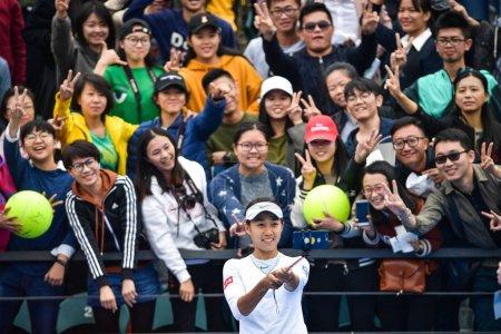 Zhang Shuai of China takes