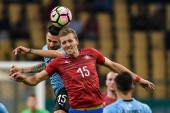Matias Vecino, top, of Uruguay national football team heads the ball to make a pass against Tomas Soucek of Czech Republic national football team in their semi-final match during the 2018 Gree China Cup International Football Championship in Nanning