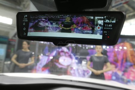 Photo for A 4G smart rearview mirror is pictured on a Jetour X70 SUV of Chery Auto on display during the 15th Beijing International Automotive Exhibition, also known as Auto China 2018, in Beijing, China, 26 April 2018 - Royalty Free Image