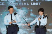 Hong Kong singers and actor Raymond Lam, left, and actress Charlene Choi of Hong Kong pop duo Twins attend a press conference for new TV series