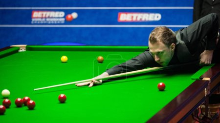 Judd Trump of England plays