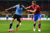 Matias Vecino, left, of Uruguay national football team kicks the ball to make a pass against Tomas Soucek of Czech Republic national football team in their semi-final match during the 2018 Gree China Cup International Football Championship in Nanning