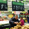 Customers shop for vegetables at a supermarket in ...