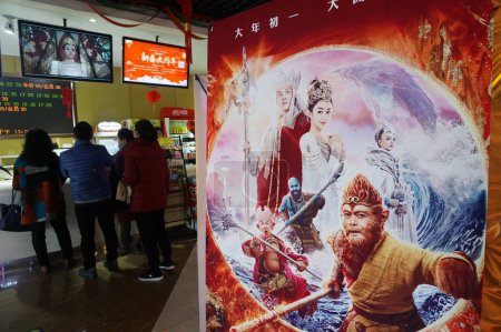 --FILE--Chinese filmgoers buy tickets near an adve...