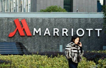 A pedestrian walks past a Marriott Hotel of Marrio...