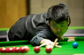 Liang Wenbo of China plays a shot to Stephen Maguire of Scotland in their 1/16 final match during the 2017 Betway UK Championship snooker tournament in York, UK, 4 December 2017