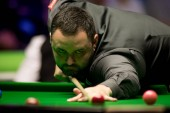 Stephen Maguire of Scotland plays a shot to Graeme Dott of Scotland in their fourth round match during the 2017 Betway UK Championship snooker tournament in York, UK, 6 December 2017