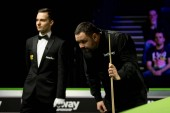 Stephen Maguire of Scotland considers a shot to Liang Wenbo of China in their 1/16 final match during the 2017 Betway UK Championship snooker tournament in York, UK, 4 December 2017
