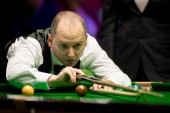Graeme Dott of Scotland plays a shot to Stephen Maguire of Scotland in their fourth round match during the 2017 Betway UK Championship snooker tournament in York, UK, 6 December 2017