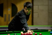 Liang Wenbo of China considers a shot to Stephen Maguire of Scotland in their 1/16 final match during the 2017 Betway UK Championship snooker tournament in York, UK, 4 December 2017