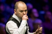 Graeme Dott of Scotland considers a shot to Stephen Maguire of Scotland in their fourth round match during the 2017 Betway UK Championship snooker tournament in York, UK, 6 December 2017