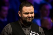 Stephen Maguire of Scotland considers a shot to Graeme Dott of Scotland in their fourth round match during the 2017 Betway UK Championship snooker tournament in York, UK, 6 December 2017