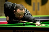 Stephen Maguire of Scotland plays a shot to Liang Wenbo of China in their 1/16 final match during the 2017 Betway UK Championship snooker tournament in York, UK, 4 December 2017