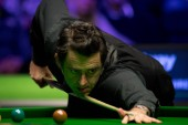 Ronnie O'Sullivan of England plays a shot to Stephen Maguire of Scotland in their semi-final match during the 2017 Betway UK Championship snooker tournament in York, UK, 9 December 2017