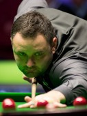 Stephen Maguire of Scotland plays a shot to Ronnie O'Sullivan of England in their semi-final match during the 2017 Betway UK Championship snooker tournament in York, UK, 9 December 2017