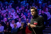 Ronnie O'Sullivan of England chalks his cue as he considers a shot to Stephen Maguire of Scotland in their semi-final match during the 2017 Betway UK Championship snooker tournament in York, UK, 9 December 2017