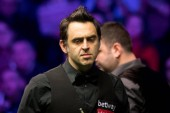 Ronnie O'Sullivan of England considers a shot to Stephen Maguire of Scotland in their semi-final match during the 2017 Betway UK Championship snooker tournament in York, UK, 9 December 2017
