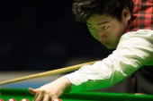 Yan Bingtao of China plays a shot to Stephen Maguire of Scotland in their third round match during the 2017 Dafabet Scottish Open snooker tournament in Glasgow, UK, 14 December 2017
