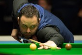 Stephen Maguire of Scotland plays a shot to Yan Bingtao of China in their third round match during the 2017 Dafabet Scottish Open snooker tournament in Glasgow, UK, 14 December 2017