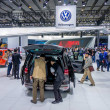 Visitors look at cars at the stand of FAW-Volkswag...