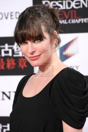American actress Milla Jovovich poses