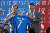 Former Dutch football player Ronald de Boer, left, attends the cooperation signing ceremony of R&F football club and AFC Ajax in Meizhou city, south China's Guangdong province, 27 November 2017