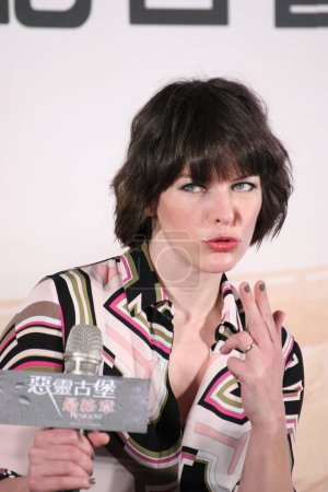 American actress Milla Jovovich reacts