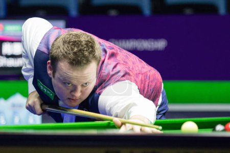Photo for Shaun Murphy of England plays a shot to Allister Carter of England in an eighth-final match during the 2017 International Championship snooker tournament in Daqing city, northeast China's Heilongjiang province, 1 November 2017 - Royalty Free Image